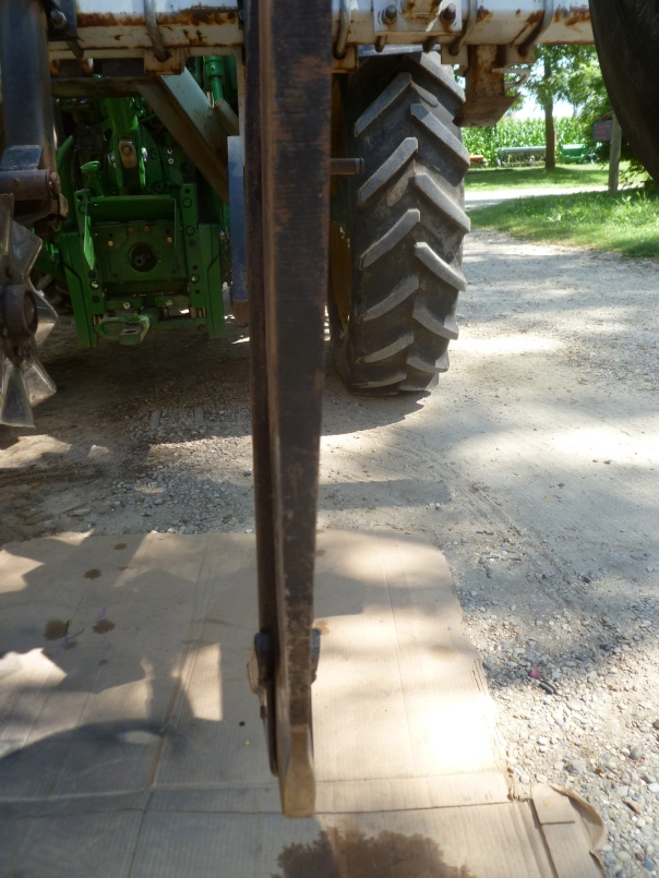 "Rear view of the subsoiler shank, which penetrates about 16"" into the ground. Notice how the shank tapers from the top, where it is about 1"" thick, to about 1/2"" towards the bottom. This tapering is from slicing through the soil acre after acre, year after year, and is exacerbated by the occasional rock."