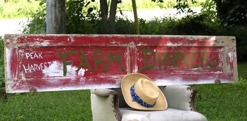 farmdinner_red_sign_chair_500x245px