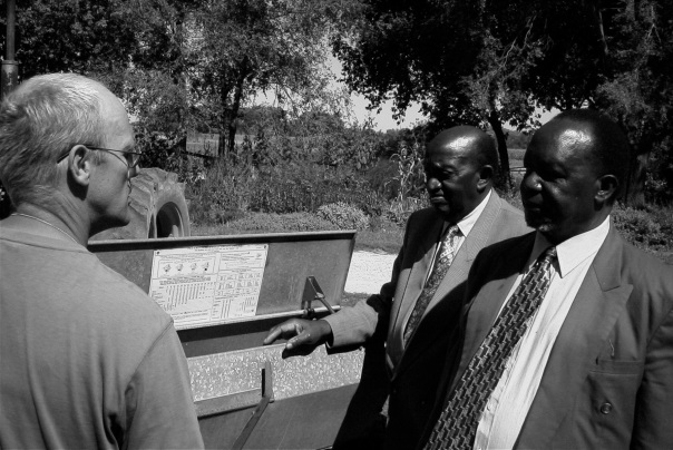 Farmer John discusses cover crops with the King and Prime Minister of Uganda, 1999