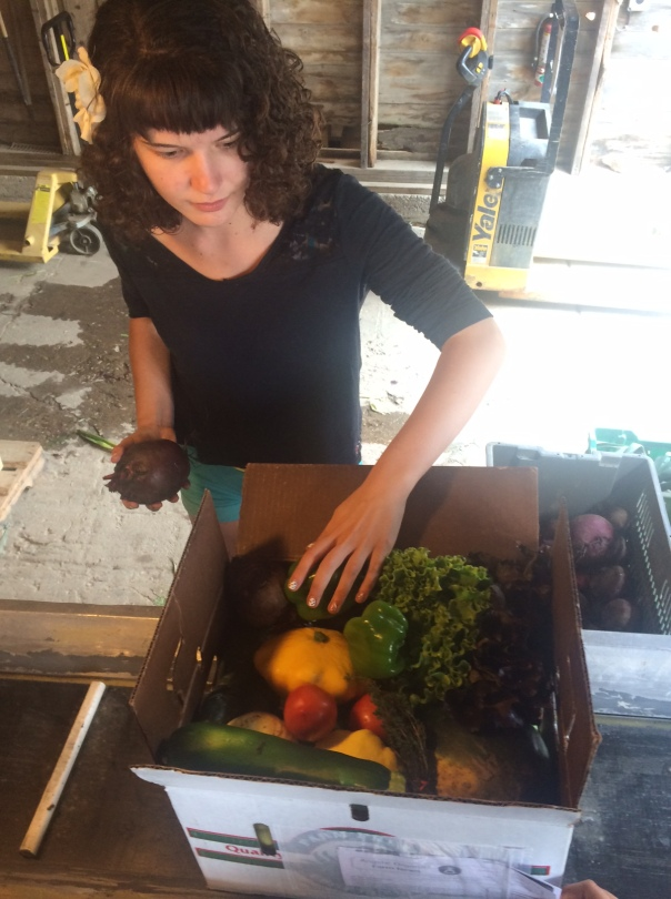 Katie puts the final touch on your box