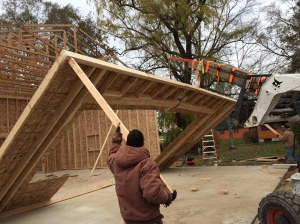 Victor (left) and Pollo help hoist the final wall into place; Primo (out of frame) is running the lift